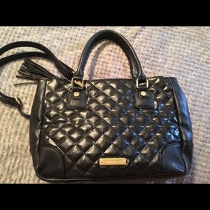 Black Steve Madden leather bag with gold zippers